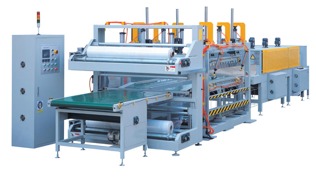 Automatic shrinking system for packing carpet rolls